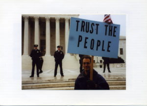 "Jonathan Simon holding ""Trust the People"" sign in Florida 2000 ..."